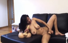 Busty Latina webcam model toying both holes
